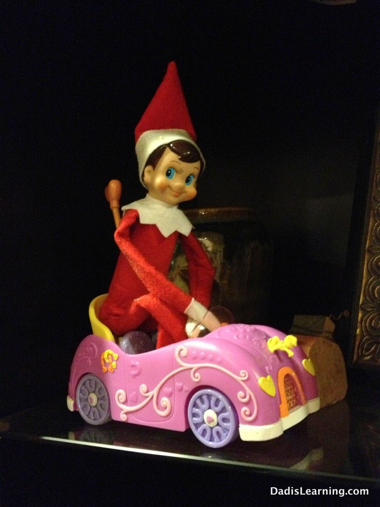 Elf on the Shelf in a remote control car
