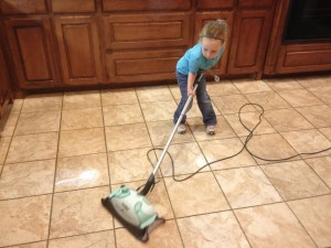 child mopping
