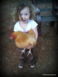 young girl holding chicken