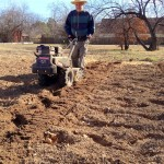 My Dad tilling in the garden this season.