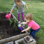 The girls watering plants this season.