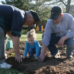 Planting seeds with my Dad and daughter in the big garden.