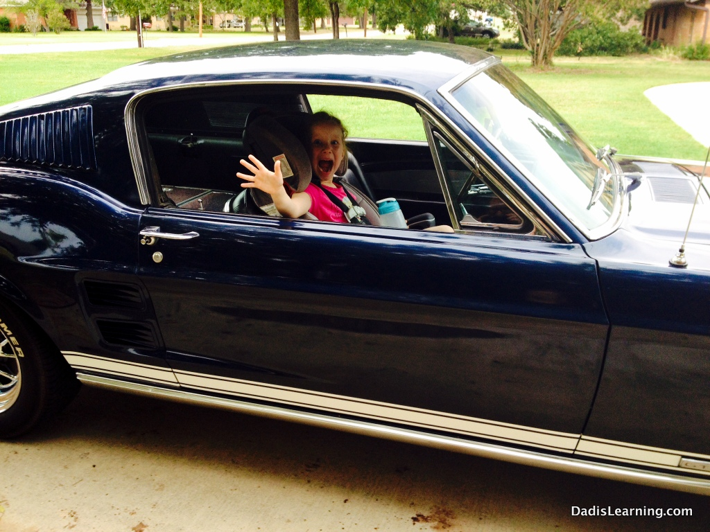 Our oldest daughter is always excited about a ride in the mustang